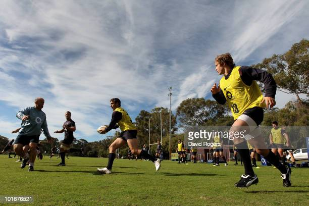 Olly Barkley runs with the ball during the England rugby training session held at McGillveray Oval on June 7 2010 in Perth Australia