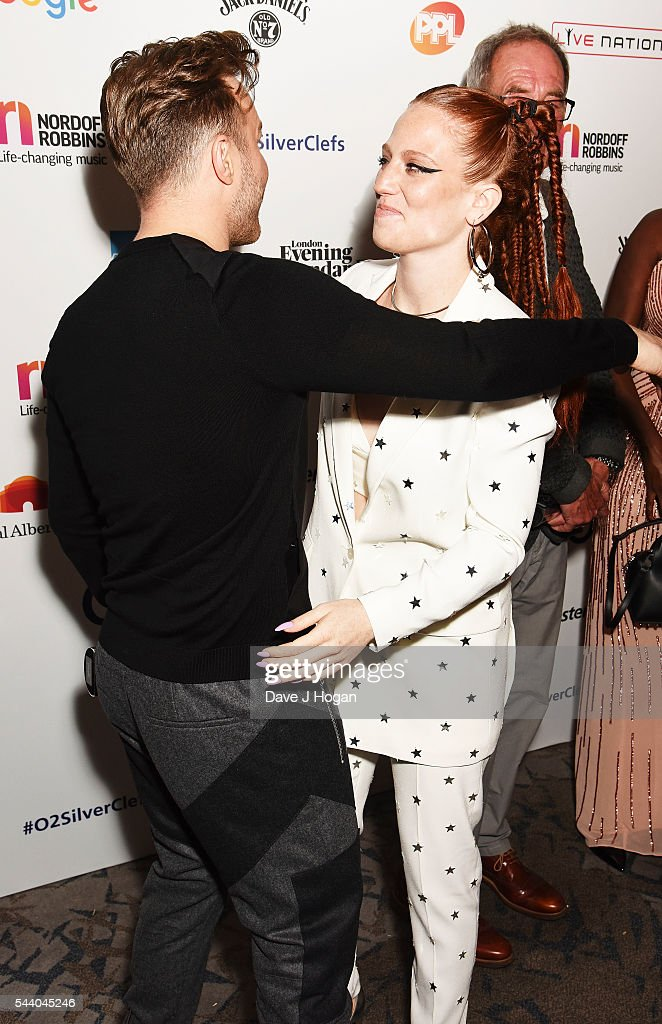 Olly Murs (L) and Jess Glynne hug during the Nordoff Robbins O2 Silver Clef Awards on July 1, 2016 in London, United Kingdom.