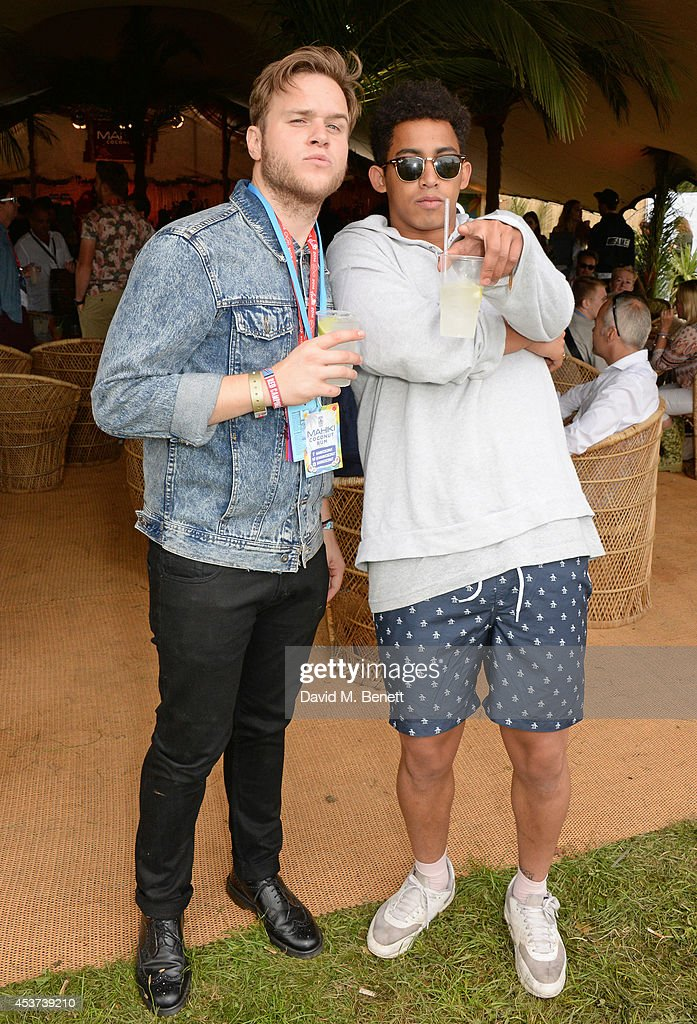 <a gi-track='captionPersonalityLinkClicked' href=/galleries/search?phrase=Olly+Murs&family=editorial&specificpeople=6350751 ng-click='$event.stopPropagation()'>Olly Murs</a> (L) and <a gi-track='captionPersonalityLinkClicked' href=/galleries/search?phrase=Jordan+Stephens&family=editorial&specificpeople=5608666 ng-click='$event.stopPropagation()'>Jordan Stephens</a> attend the Mahiki Rum Bar for the launch of the Mahiki Rum Family backstage during day 2 of the V Festival 2014 at Hylands Park on August 17, 2014 in Chelmsford, England.