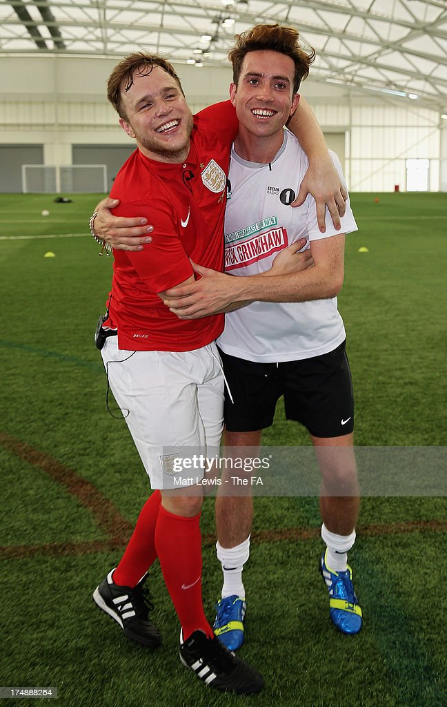 <a gi-track='captionPersonalityLinkClicked' href=/galleries/search?phrase=Olly+Murs&family=editorial&specificpeople=6350751 ng-click='$event.stopPropagation()'>Olly Murs</a> (L) and <a gi-track='captionPersonalityLinkClicked' href=/galleries/search?phrase=Nick+Grimshaw&family=editorial&specificpeople=4666727 ng-click='$event.stopPropagation()'>Nick Grimshaw</a> go head to head in the BBC Radio 1 five-a-side football match between Team Grimshaw, captained by BBC Radio 1 DJ <a gi-track='captionPersonalityLinkClicked' href=/galleries/search?phrase=Nick+Grimshaw&family=editorial&specificpeople=4666727 ng-click='$event.stopPropagation()'>Nick Grimshaw</a> and Team Murs, captained by singer and FA150 ambassador <a gi-track='captionPersonalityLinkClicked' href=/galleries/search?phrase=Olly+Murs&family=editorial&specificpeople=6350751 ng-click='$event.stopPropagation()'>Olly Murs</a>, at St Georges Park on July 29, 2013 in Burton-upon-Trent, England. In the build-up to Sir Bobby Robson National Football Day on August 10, the 5-a-side match was one of many events taking place around the country to mark The FA's 150th anniversary.