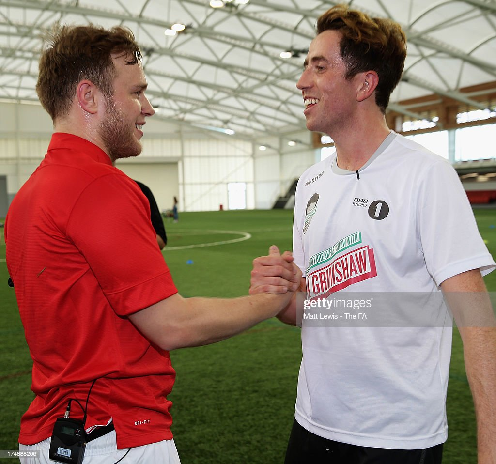 <a gi-track='captionPersonalityLinkClicked' href=/galleries/search?phrase=Olly+Murs&family=editorial&specificpeople=6350751 ng-click='$event.stopPropagation()'>Olly Murs</a> (L) and <a gi-track='captionPersonalityLinkClicked' href=/galleries/search?phrase=Nick+Grimshaw&family=editorial&specificpeople=4666727 ng-click='$event.stopPropagation()'>Nick Grimshaw</a> shake hands during the BBC Radio 1 five-a-side football match between Team Grimshaw, captained by BBC Radio 1 DJ <a gi-track='captionPersonalityLinkClicked' href=/galleries/search?phrase=Nick+Grimshaw&family=editorial&specificpeople=4666727 ng-click='$event.stopPropagation()'>Nick Grimshaw</a> and Team Murs, captained by singer and FA150 ambassador <a gi-track='captionPersonalityLinkClicked' href=/galleries/search?phrase=Olly+Murs&family=editorial&specificpeople=6350751 ng-click='$event.stopPropagation()'>Olly Murs</a>, at St Georges Park on July 29, 2013 in Burton-upon-Trent, England. In the build-up to Sir Bobby Robson National Football Day on August 10, the 5-a-side match was one of many events taking place around the country to mark The FA's 150th anniversary.