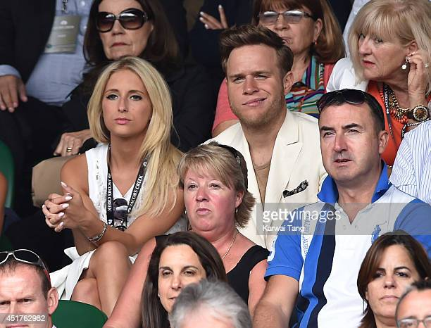 Olly Murs attends the mens singles final between Novak Djokovic and Roger Federer on centre court during day thirteen of the Wimbledon Championships...