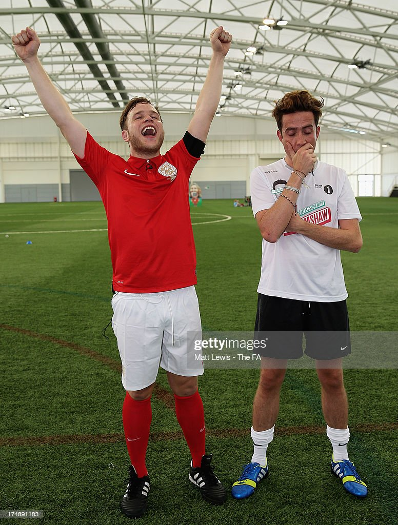 <a gi-track='captionPersonalityLinkClicked' href=/galleries/search?phrase=Olly+Murs&family=editorial&specificpeople=6350751 ng-click='$event.stopPropagation()'>Olly Murs</a>, Captain of Team Murs celebrates his team's win,as <a gi-track='captionPersonalityLinkClicked' href=/galleries/search?phrase=Nick+Grimshaw&family=editorial&specificpeople=4666727 ng-click='$event.stopPropagation()'>Nick Grimshaw</a>, Captain of Team Grimshaw looks on after the BBC Radio 1 five-a-side football match between Team Grimshaw, captained by BBC Radio 1 DJ <a gi-track='captionPersonalityLinkClicked' href=/galleries/search?phrase=Nick+Grimshaw&family=editorial&specificpeople=4666727 ng-click='$event.stopPropagation()'>Nick Grimshaw</a> and Team Murs, captained by singer and FA150 ambassador <a gi-track='captionPersonalityLinkClicked' href=/galleries/search?phrase=Olly+Murs&family=editorial&specificpeople=6350751 ng-click='$event.stopPropagation()'>Olly Murs</a>, at St Georges Park on July 29, 2013 in Burton-upon-Trent, England. In the build-up to Sir Bobby Robson National Football Day on August 10, the five-a-side match was one of many events taking place around the country to mark The FA's 150th anniversary.
