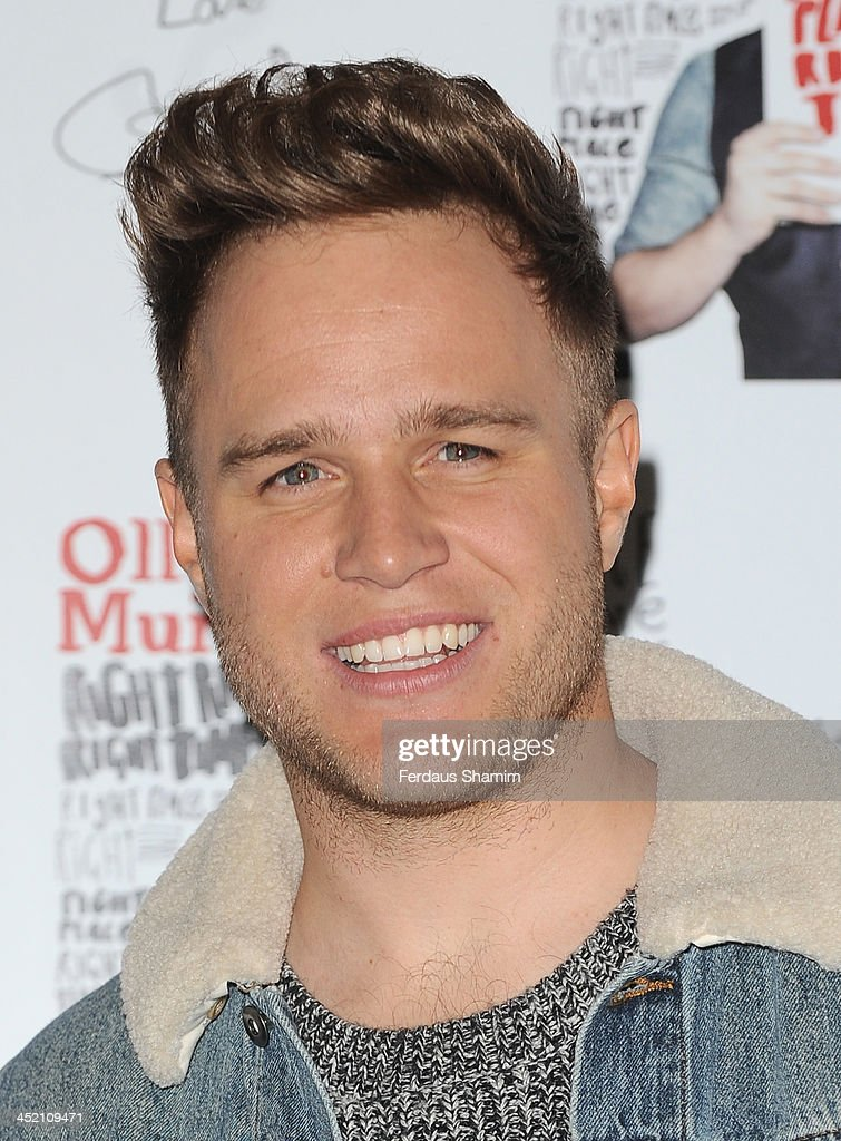 <a gi-track='captionPersonalityLinkClicked' href=/galleries/search?phrase=Olly+Murs&family=editorial&specificpeople=6350751 ng-click='$event.stopPropagation()'>Olly Murs</a> meets fans and signs copies of his new album & DVD 'Right Place Right Time' at HMV, Oxford Street on November 26, 2013 in London, England.