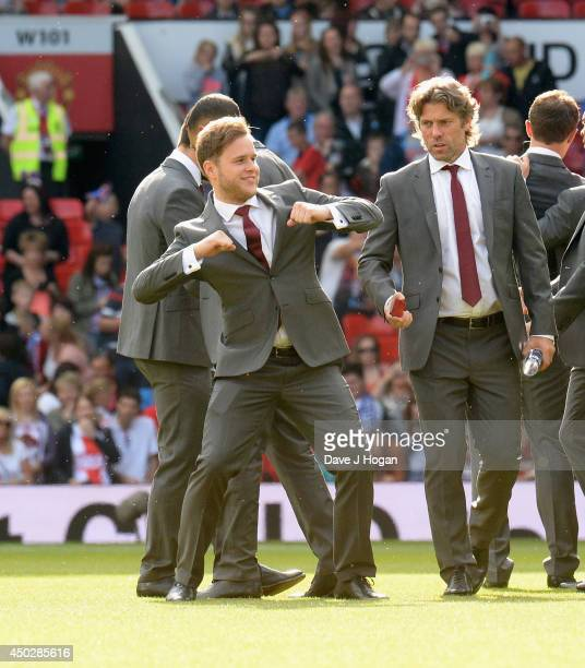 Olly Murs of England dances on the pitch ahead of Soccer Aid 2014 at Old Trafford on June 8 2014 in Manchester England