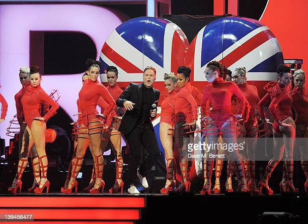 Olly Murs performs during the BRIT Awards 2012 held at the O2 Arena on February 21 2012 in London England