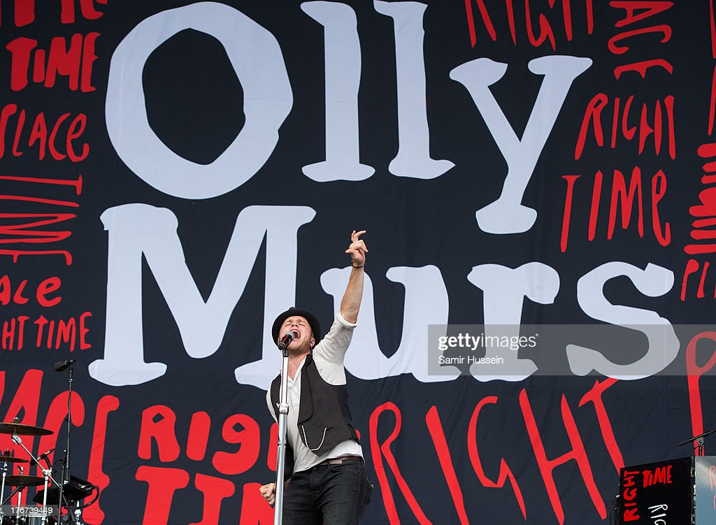 Olly Murs performs live on the Virgin Media Stage on day 2 of V Festival at Hylands Park on August 18, 2013 in Chelmsford, England.
