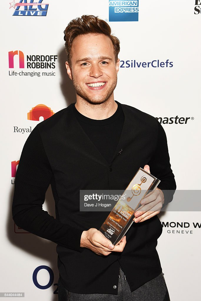 <a gi-track='captionPersonalityLinkClicked' href=/galleries/search?phrase=Olly+Murs&family=editorial&specificpeople=6350751 ng-click='$event.stopPropagation()'>Olly Murs</a> poses with the AEG Live Best Male Artist Award during the Nordoff Robbins O2 Silver Clef Awards on July 1, 2016 in London, United Kingdom.