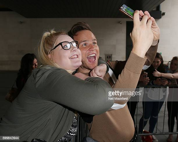 Olly Murs takes a selfie with a fan as he is seen at BBC Radio One on September 7 2016 in London England