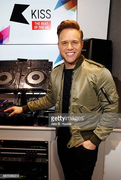 Olly Murs visits Ricky Melvin and Charlie on Kiss Breakfast at Kiss FM on October 12 2015 in London England