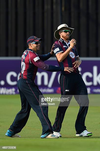Olly Stone of Northamptonshire celebrates with team mate Kyle Coetzer after catching Luke Wright of Sussex for a duck during the NatWest T20 Blast...