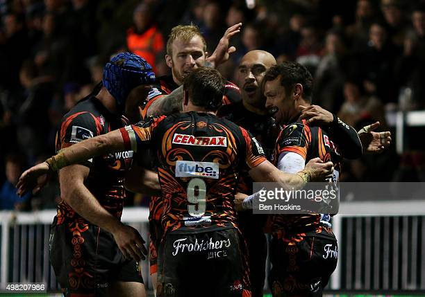 Olly Woodburn of Exeter celebrates with team mates after scoring a try during the European Rugby Champions Cup match between Exeter Chiefs and...