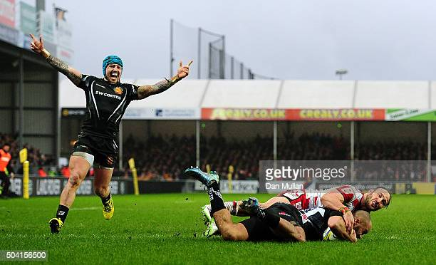 Olly Woodburn of Exeter Chiefs dives over for his side's third try as Jack Nowell of Exeter Chiefs celebrates during the Aviva Premiership match...