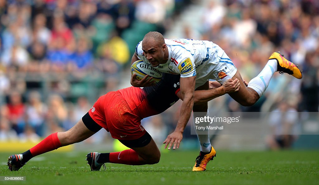 Olly Woodburn of Exeter Chiefs is tackled by <a gi-track='captionPersonalityLinkClicked' href=/galleries/search?phrase=Alex+Goode&family=editorial&specificpeople=2060375 ng-click='$event.stopPropagation()'>Alex Goode</a> of Saracens during the Aviva Premiership final match between Saracens and Exeter Chiefs at Twickenham Stadium on May 28, 2016 in London, England.