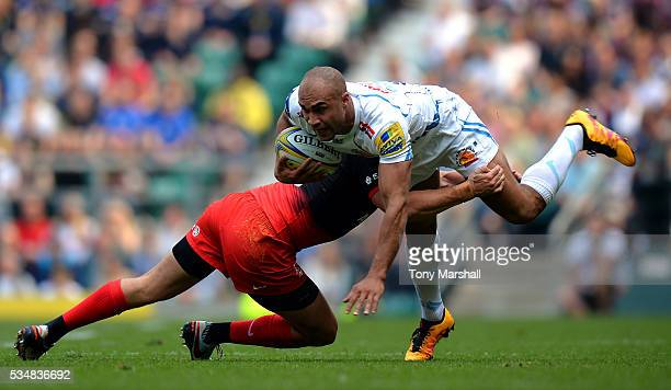 Olly Woodburn of Exeter Chiefs is tackled by Alex Goode of Saracens during the Aviva Premiership final match between Saracens and Exeter Chiefs at...