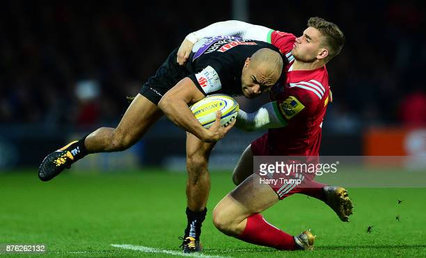 Olly Woodburn of Exeter Chiefs is tackled by James Lang of Harlequins during the Aviva Premiership match between Exeter Chiefs and Harlequins at...