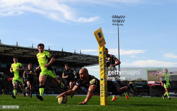 Olly Woodburnof Exeter Chiefs goes over for his sides third try during the Aviva Premiership match between Exeter Chiefs and Sale Sharks at Sandy...