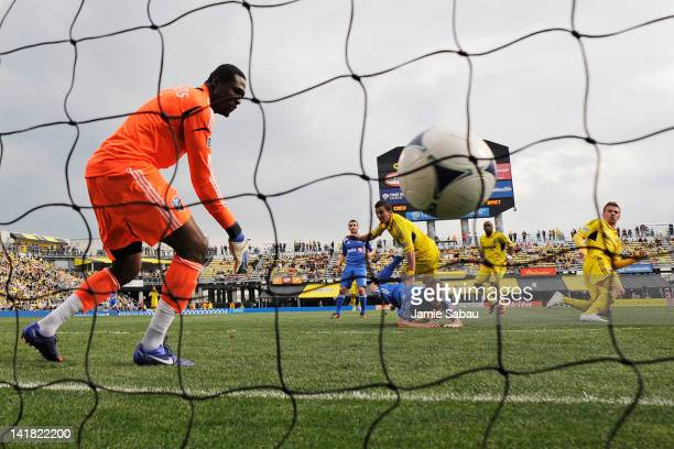Olman Vargas of the Columbus Crew heads the ball past goalkeeper Donovan Ricketts of the Montreal Impact in the second half for the game's second...