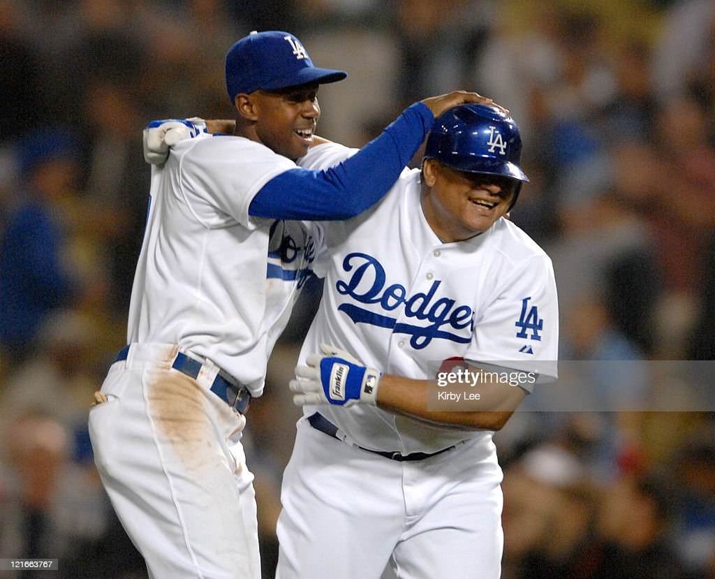 <a gi-track='captionPersonalityLinkClicked' href=/galleries/search?phrase=Olmedo+Saenz&family=editorial&specificpeople=211447 ng-click='$event.stopPropagation()'>Olmedo Saenz</a> of the Los Angeles Dodgers, right, is congratulated by <a gi-track='captionPersonalityLinkClicked' href=/galleries/search?phrase=Juan+Pierre&family=editorial&specificpeople=202961 ng-click='$event.stopPropagation()'>Juan Pierre</a> after hitting a game-winning single in the bottom of the ninth inning of 2-1 victory over the Arizona Diamondbacks at Dodger Stadium in Los Angeles, Calif. on Tuesday, May 1, 2007.