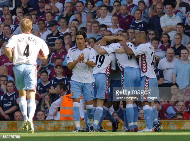 Olof Mellberg Aston Villa runs to join Juan Pablo Angel and team mates to celebrate Liam Ridgewell's opening goal