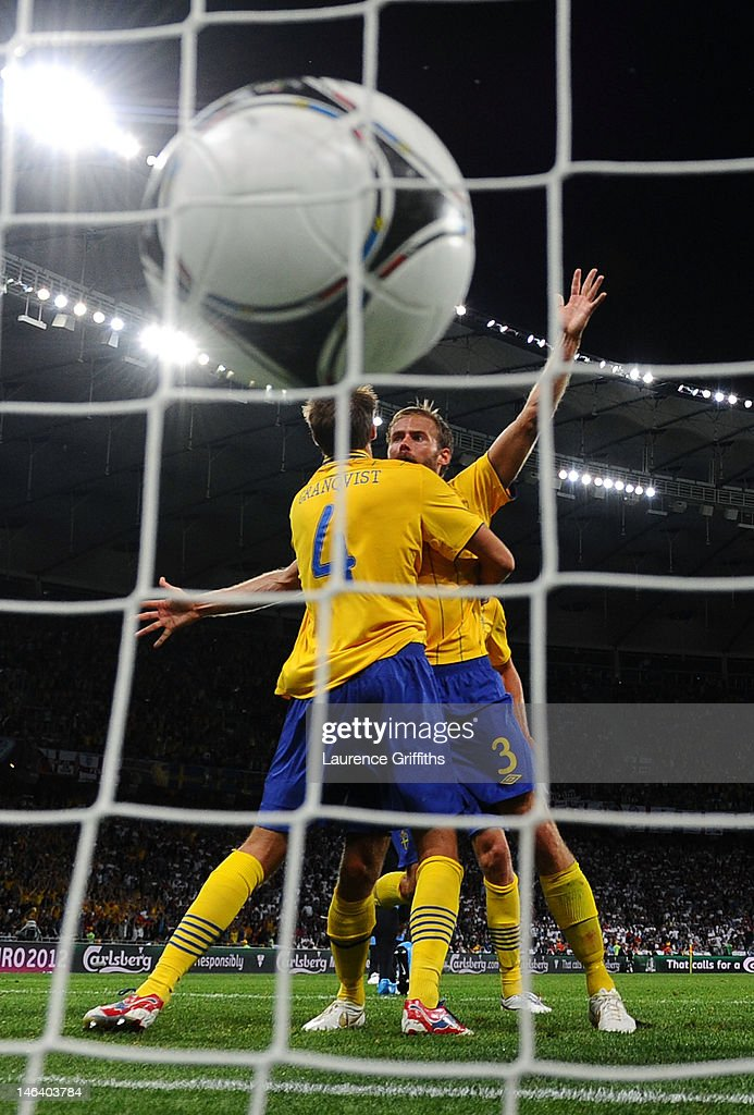 <a gi-track='captionPersonalityLinkClicked' href=/galleries/search?phrase=Olof+Mellberg&family=editorial&specificpeople=215028 ng-click='$event.stopPropagation()'>Olof Mellberg</a> of Sweden celebrates scoring their second goal with with <a gi-track='captionPersonalityLinkClicked' href=/galleries/search?phrase=Andreas+Granqvist&family=editorial&specificpeople=3016250 ng-click='$event.stopPropagation()'>Andreas Granqvist</a> of Sweden during the UEFA EURO 2012 group D match between Sweden and England at The Olympic Stadium on June 15, 2012 in Kiev, Ukraine.