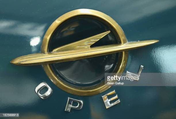 Ols Opel logos decorate historic Opel cars on display at the Opel Insignia and Astra factory during a celebration marking Opel's 150th anniversary on...