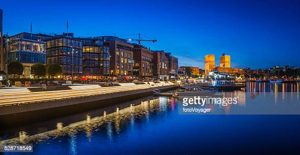 Olso illuminated harbour waterfront Aker Brygge restaurants apartments panorama Norway