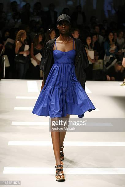 Oluchi Onweagba wearing DKNY Spring 2007 during Olympus Fashion Week Spring 2007 DKNY Runway at 711 Greenwich Street in New York City New York United...
