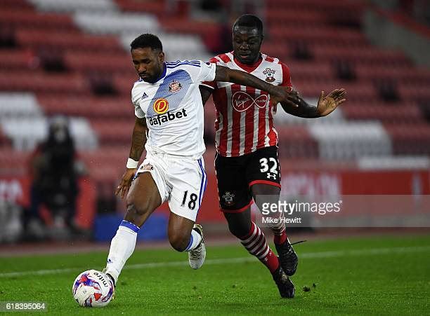 Olufela Olomola of Southampton and Jermain Defoe of Sunderland battle for possession during the EFL Cup fourth round match between Southampton and...