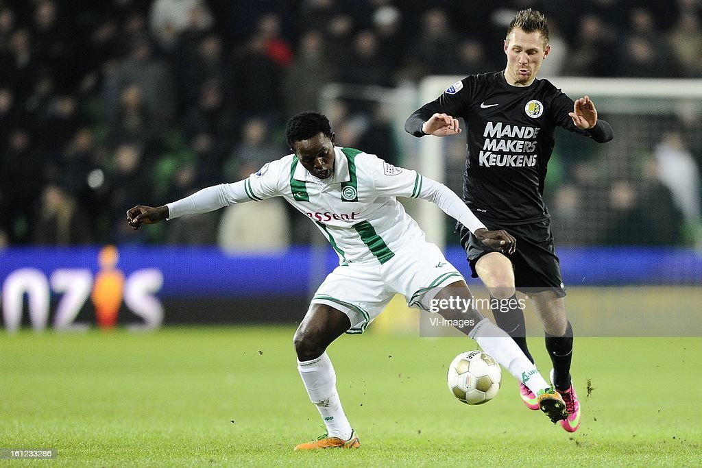 Oluwafemi Ajilore of FC Groningen, Teddy Chevalier of RKC Waalwijk, during the Dutch Eredivisie match between FC Groningen and RKC Waalwijk at the Euroborg on february 9, 2013 in Groningen, The Netherlands
