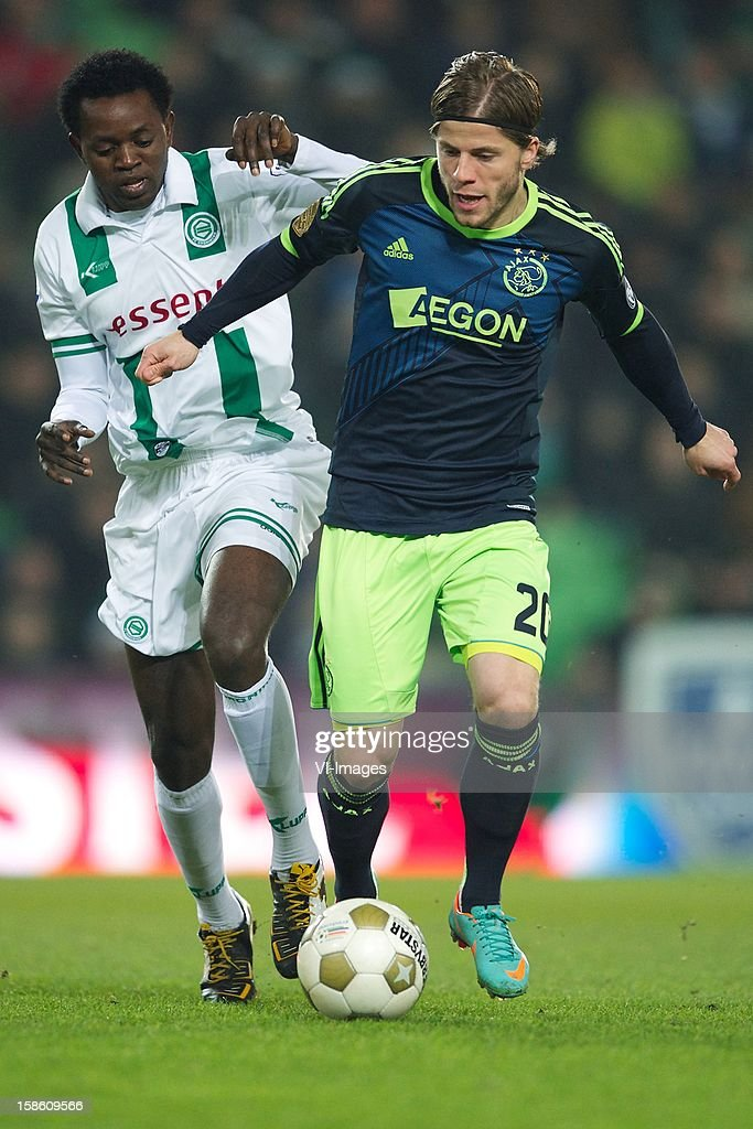 Oluwafemi Ajilorse of FC Groningen, Lasse Schone of Ajax during the Dutch Cup match between FC Groningen and Ajax Amsterdam at the Euroborg on December 20, 2012 in Groningen, The Netherlands.
