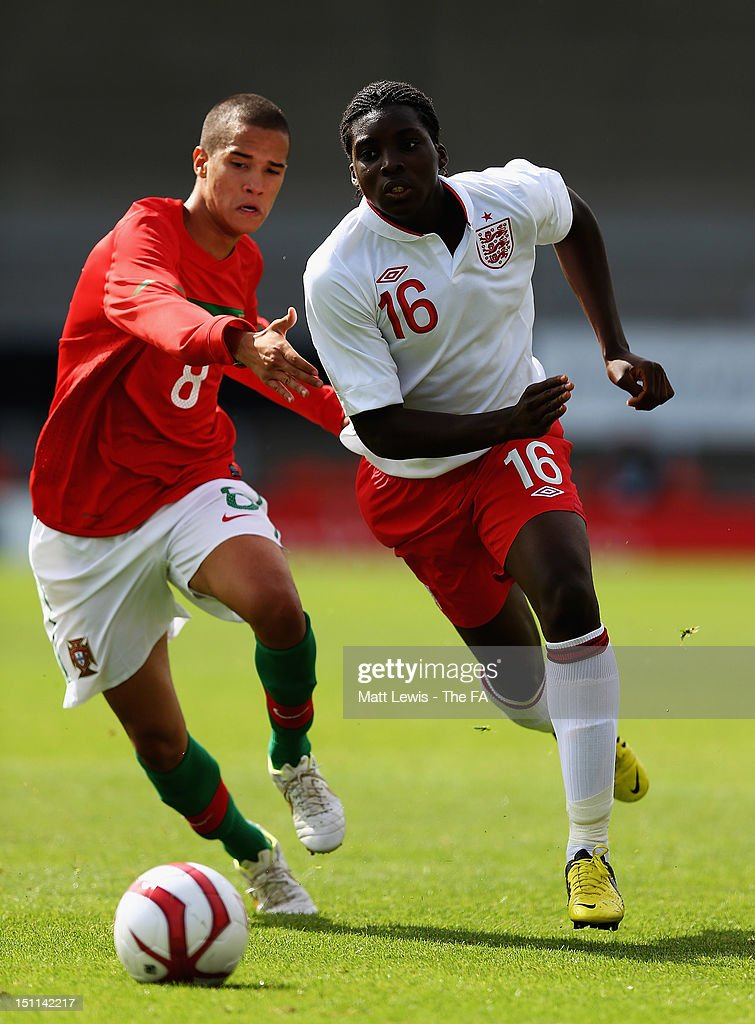 Oluwaseyi Ojo of England and Clever of Portugal challenge for the ball during the match between England U17 and Portugal U17 at Pirelli Stadium on September 2, 2012 in Burton-upon-Trent, England.