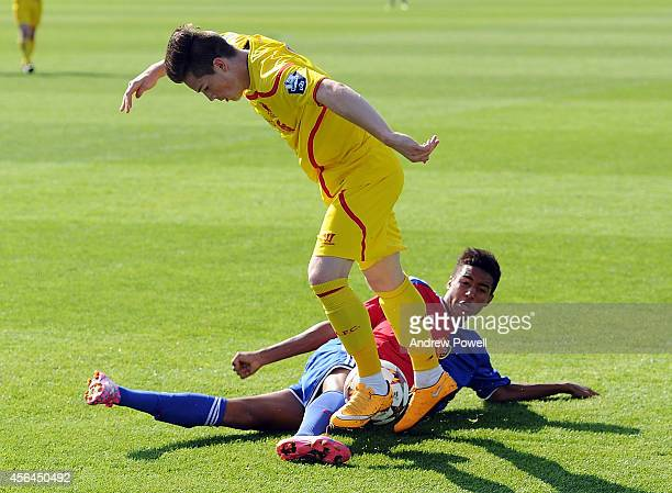 Oluwaseyi Ojo of Liverpool competes with Charles Pickel of FC Basel 1893 during the UEFA Youth League match between FC Basel 1893 Under 19s and...