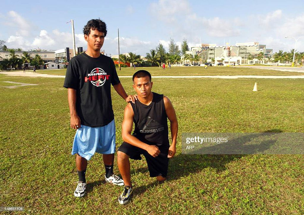 Oly-2012-athletics-Marshalls,FEATURE by Giff Johnson This undated photo received on June 27, 2012 shows Marshall Islander Timi Garstang (R) with Jamodre Lalita on the grass field where they trained for months in Majuro in preparation for the London Olympic Games. When Marshall Islands sprinter Timi Garstang steps into London's Olympic Stadium, he will be in a facility that holds 30,000 more people than the entire population of his Pacific nation. AFP PHOTO / Giff Johnson