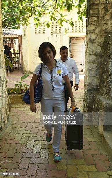 WITH 'OLY2016INDshooting' INTERVIEW by Peter HUTCHISON In this photograph taken on April 25 Indian shooter Heena Sidhu arrives for a training session...