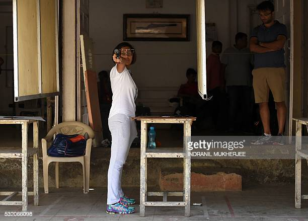 WITH 'OLY2016INDshooting' INTERVIEW by Peter HUTCHISON In this photograph taken on April 25 Indian shooter Heena Sidhu takes aim during a training...