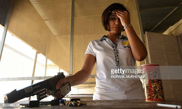 WITH 'OLY2016INDshooting' INTERVIEW by Peter HUTCHISON In this photograph taken on April 25 Indian shooter Heena Sidhu takes part in a training...