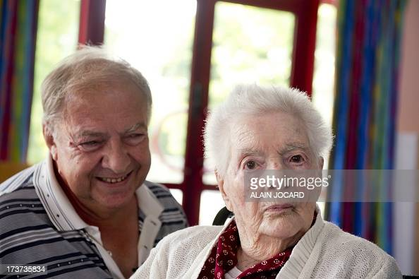 Olympe Amaury 112 years old the oldest 'known' person living in France poses with her son Claude 73 on July 17 2013 in Amilly near Montargis central...