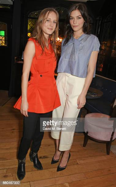 Olympia Campbell and Amber Anderson attend the Carven dinner hosted by new creative director Serge Ruffieux at Clarette on November 27 2017 in London...