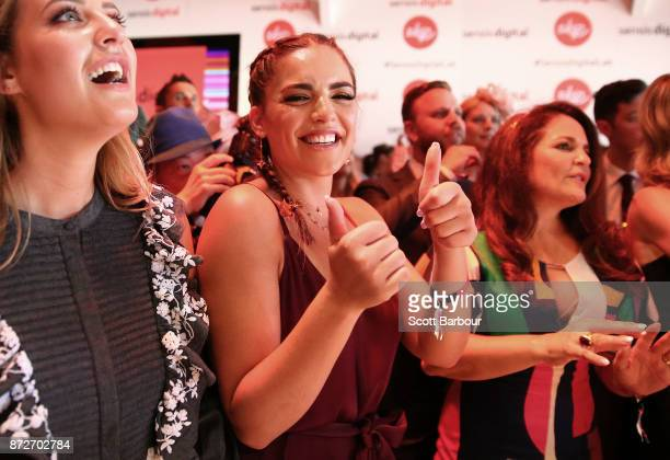 Olympia Valance dances as Natalie Bassingthwaighte performs at the Sensis Marquee on Stakes Day at Flemington Racecourse on November 11 2017 in...
