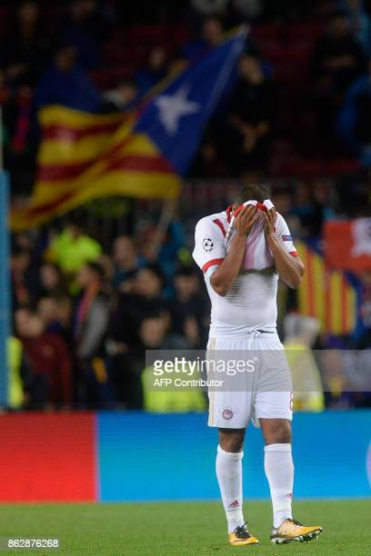 Olympiacos' Belgian midfielder Vadis Ofoe wipes his face during the UEFA Champions League group D football match FC Barcelona vs Olympiacos FC at the...