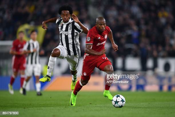 Olympiacos' Brazilian forward Seba vies with Juventus' forward from Colombia Juan Cuadrado during the UEFA Champion's League Group D football match...