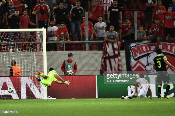 Olympiacos' Colombian midfielder Felipe Pardo scores his team's second goal during the UEFA Champions League Group D football match between...