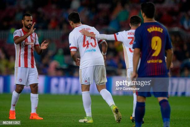 Olympiacos' defender Dimitris Nikolaou celebrates a goal during the UEFA Champions League Group D football match between FC Barcelona vs Olympiacos...