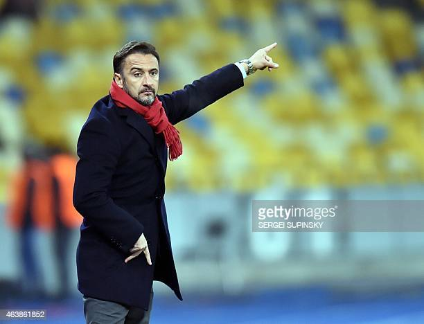 Olympiacos FC coach Vitor Manuel De Oliveira Lopes Pereira reacts during the UEFA Europa League round of 32 first leg football match FC Dnipro vs...