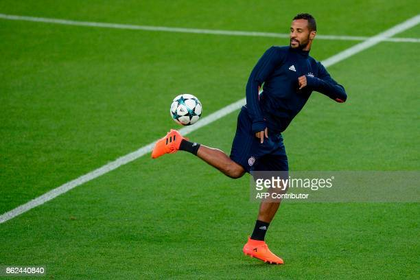 Olympiacos' FrenchTogolese midfielder Alaixys Romao controls the ball during a training session at the Camp Nou stadium in Barcelona on October 17...