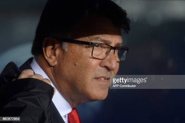Olympiacos' Greek coach Takis Lemonis looks on during the UEFA Champions League group D football match FC Barcelona vs Olympiacos FC at the Camp Nou...