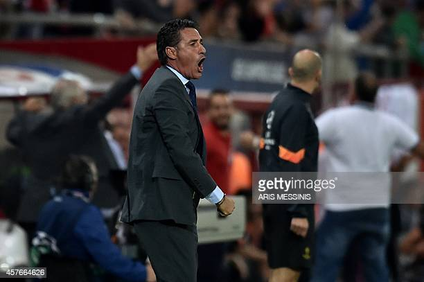 Olympiacos' head coach Michel whose full name is Jose Miguel Gonzalez Martín del Campo reacts after Olympiacos scored a goal during the Group A...