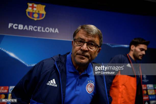 Olympiacos' head coach Takis Lemonis and Olympiacos' Spanish defender Alberto Botia arrive to gives a press conference at the Camp Nou staduium in...