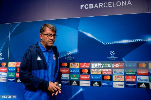 Olympiacos' head coach Takis Lemonis arrives to give a press conference in Barcelona on October 17 2017 on the eve of the UEFA Champions League group...
